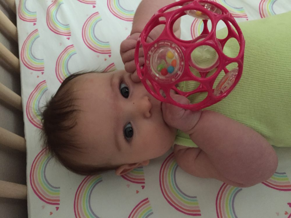 baby with the oball nipple hack - how we eased my breastfed baby into drinking from a bottle. what to do when baby won't take a bottle